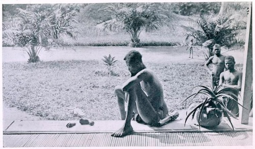 Nsala, of the district of Wala, looking at the severed hand and foot of his five-year old daughter, Boali, who was killed and allegedly cannibalized by the members of Anglo-Belgian India Rubber Company (A.B.I.R.) militia. Source: E. D Morel, King Leopold's rule in Africa, between pages 144 and 145