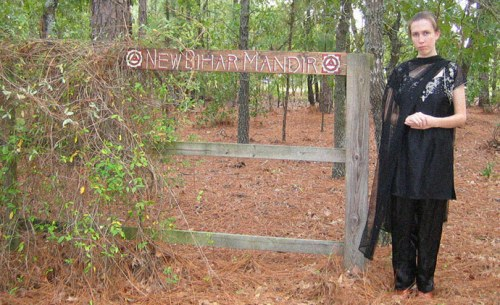 "Jillian Hoy, wife of white power leader, pro North Korea advocate, and Jim Jones supporter Joshua Caleb Sutter. Here Hoy, who bills herself a Hindu priestess Jayalalita Devi Dasi, is pictured at the rural South Carolina property where the Hindu temple New Bihar Mandir is located which worships the deity Kali, the ""Goddess of Destruction"" is located"