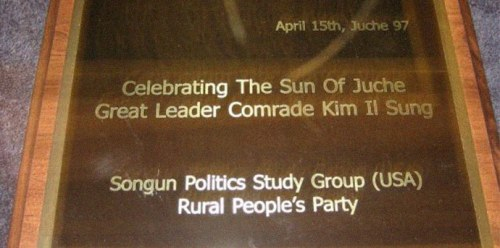 A plaque presented by the Rural People's Party and Songun Politics Study Group to Kim Jong Il on Kim Il Sung's birthday