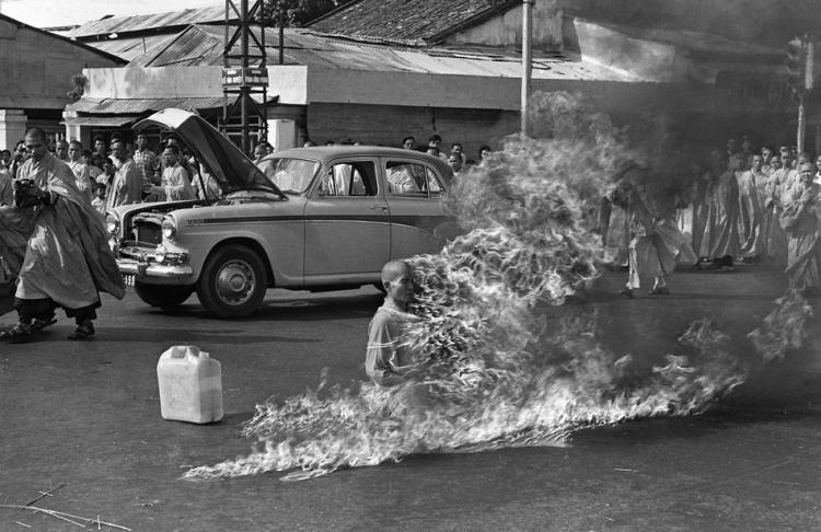 Quang Duc, a Buddhist monk, burns himself to death on a Saigon street on June 11, 1963, to protest persecution of Buddhists by the South Vietnamese government. (AP Photo/Malcolm Browne, File)