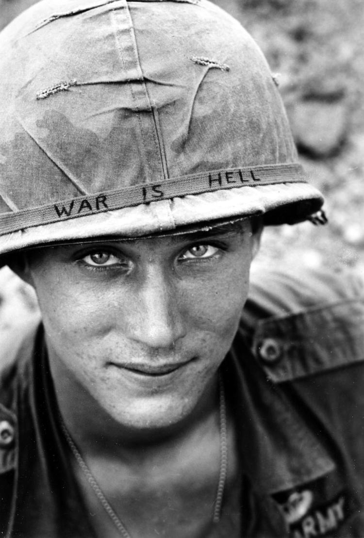 "An unidentified U.S. Army soldier wears a hand lettered ""War Is Hell"" slogan on his helmet, in Vietnam on June 18, 1965. (AP Photo/Horst Faas, File)"