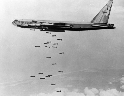 A U.S. B-52 stratofortress drops a load of 750-pounds bombs over a Vietnam coastal area during the Vietnam War, Nov. 5, 1965. (AP Photo/USAF)