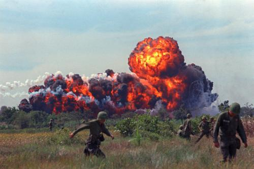 A napalm strike erupts in a fireball near U.S. troops on patrol in South Vietnam, 1966 during the Vietnam War. (AP Photo)