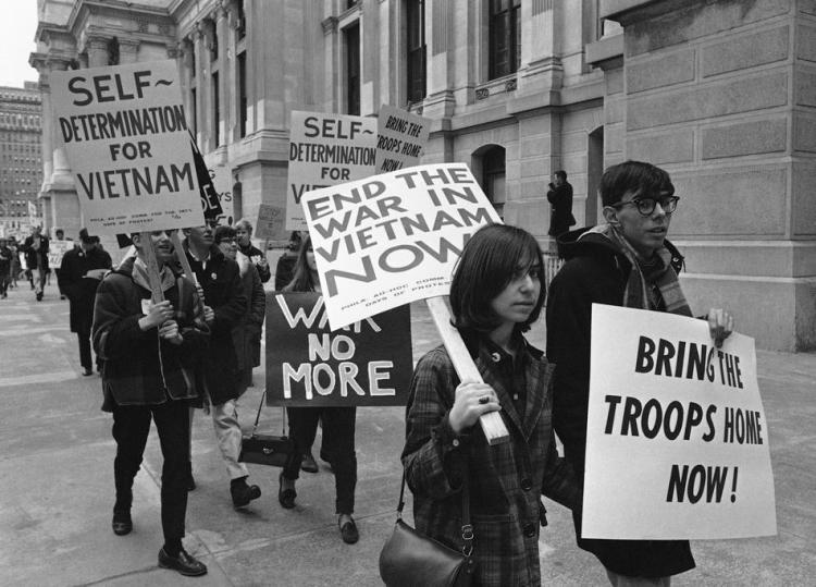 Seen here are pickets demonstrating against the Vietnam War as they march through downtown Philadelphia, Pa, March, 26 1966. (AP Photo/Bill Ingraham)