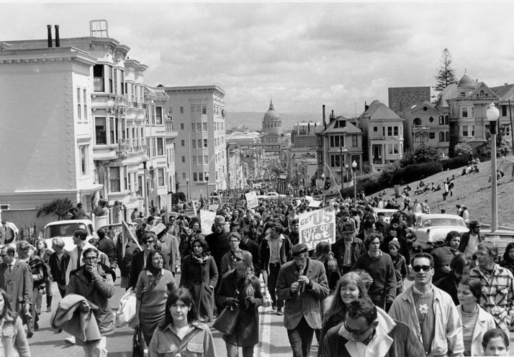 Anti-Vietnam war demonstrators fill Fulton Street in San Francisco on April 15, 1967. The five-mile march through the city would end with a peace rally at Kezar Stadium. In the background is San Francisco City Hall. (AP Photo)