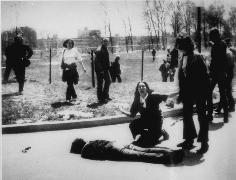 Mary Ann Vecchio gestures and screams as she kneels by the body of a student lying face down on the campus of Kent State University, Kent, Ohio on May 4, 1970. National Guardsmen had fired into a crowd of demonstrators, killing four. (AP Photo/John Filo)