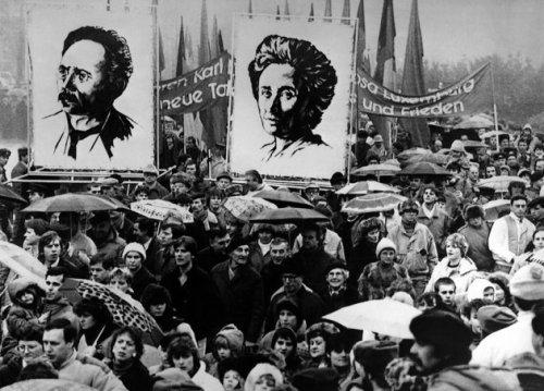 Demonstrators in East Berlin carry portraits of both German socialist Karl Liebknecht and political activist Rosa Luxemburg in 1988, during a protest march against their assassination in 1919. (AP/Press Association Images)
