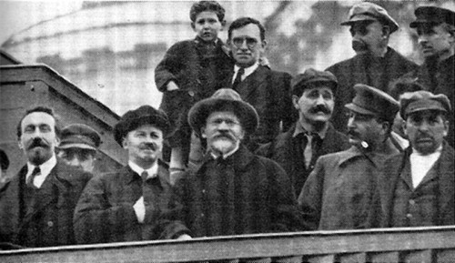 Lenin's Tomb, 1927. (Left to Right) Rykov, Bukharin, Kalinin, Uglanov, Stalin, Tomsky. (Back Row) Murphy and son, Gordon.