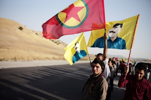 Members of the PKK wait to greet the body of a slain Iraqi Kurdish PKK fighter on the road from Erbil.Ayman Oghanna for Al Jazeera America