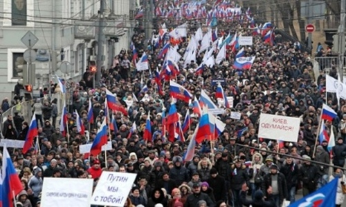 Russians march in central Moscow. Photograph: Sergei Karpukhin/Reuters SERGEI KARPUKHIN/REUTERS